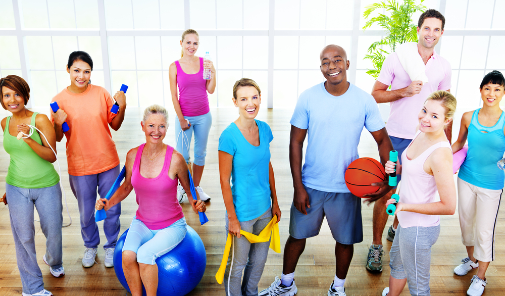 Group of people holding different workout/sports things