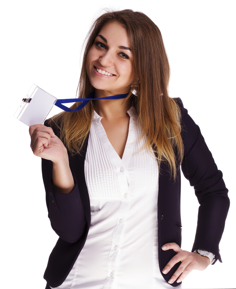 Girl holding up a blank name tag