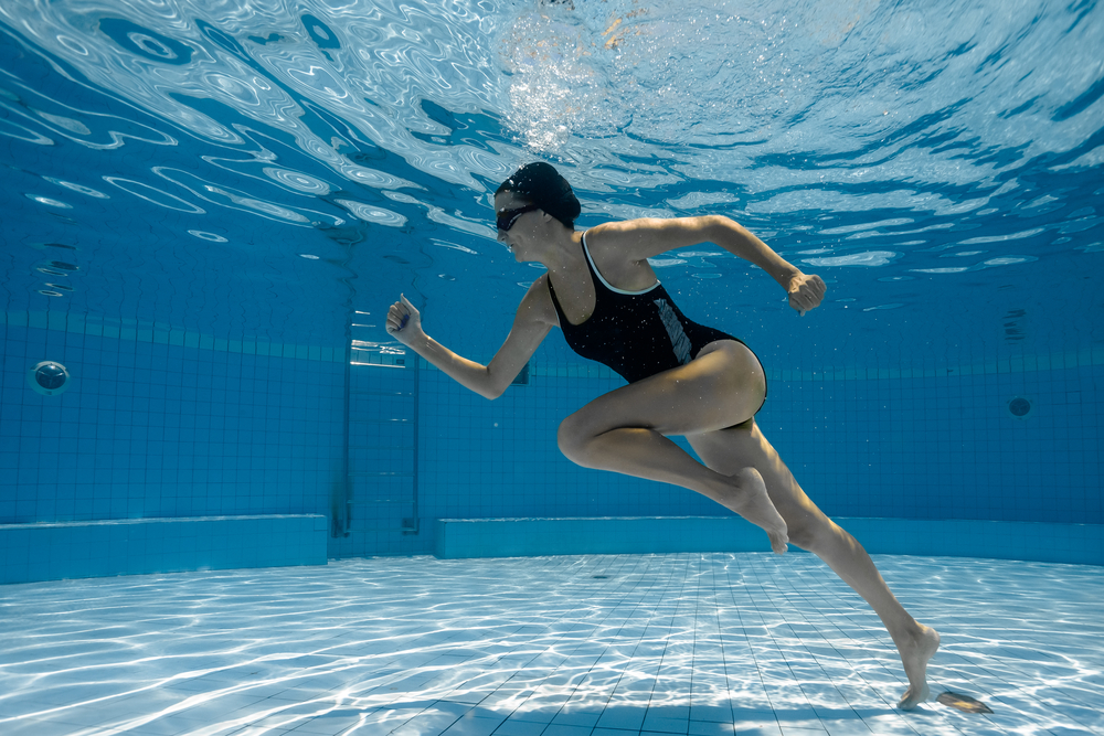 Girl underwater doing pool exercises