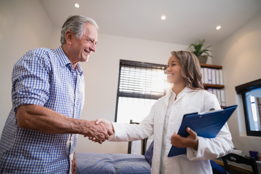 Physical therapist meeting a patient